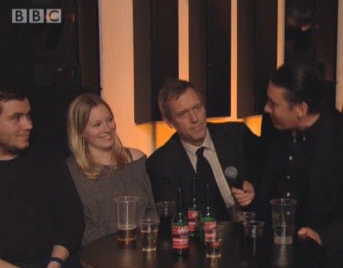 Hugh Laurie wallpaper probably containing a dinner table, a brasserie, and a bistro titled Hugh Laurie chats to Jools Holland - BBC 20.12.2012  Rebecca and Charlie.)