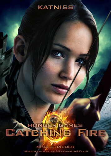 Catching Fire wallpaper probably containing a sign and a portrait entitled Katniss - Catching Fire