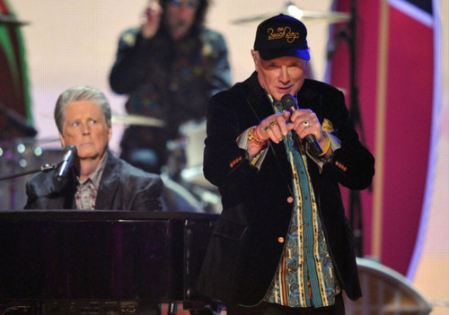 Mike Love points like always....Brian Wilson looks annoyed.