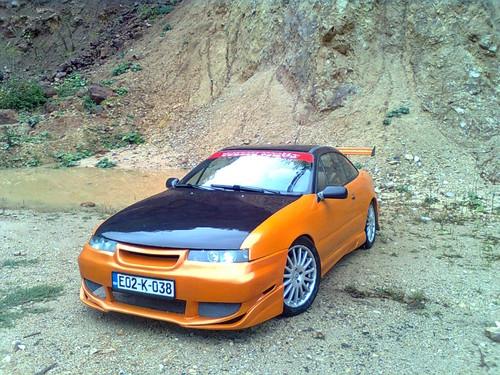跑车 壁纸 possibly with a coupe, a sedan, and a roadster called Opel Calibra Tuning