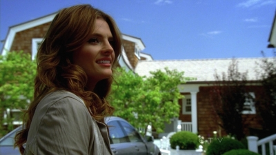 Stana Katic achtergrond probably with a straat titled Stana in Castle's 5x04