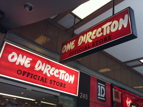 One Direction wallpaper possibly with a tobacco shop, a diner, and a package store entitled The store