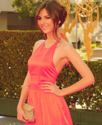 Victoria Justice wallpaper possibly with a cocktail dress, a bouquet, and a dress called Victoria