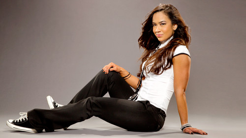AJ Lee wallpaper with a well dressed person and a business suit titled AJ Lee