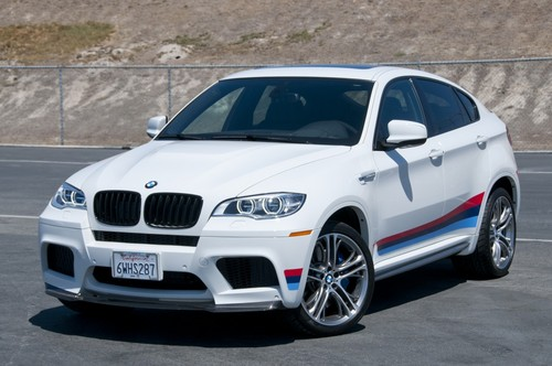 BMW wallpaper with a sedan, a hatchback, and a hatchback entitled BMW X6M