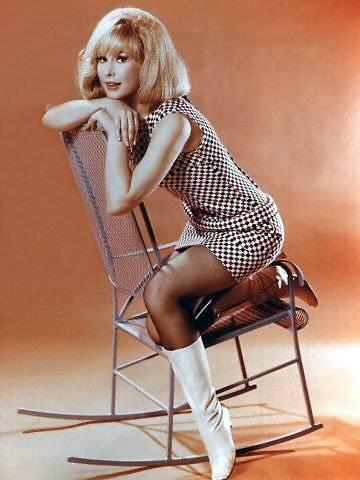 Barbara Eden Hintergrund possibly with a rocking chair titled Barbara Eden