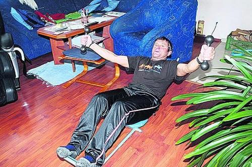 Josef Vana strengthens with dumbbells