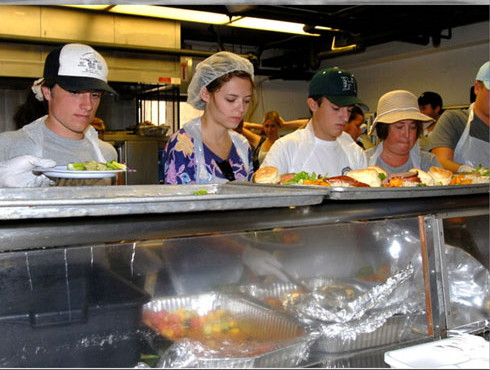 Josh at Honolulu's homeless shelters, serving over 250 meals