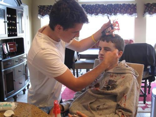Josh doing Connor's makeup for Halloween