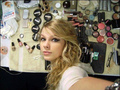 Taylor Swift with her makeup products