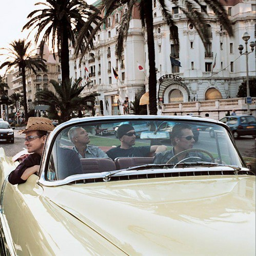 U2 壁紙 possibly with a convertible, a street, and a roadster entitled U2