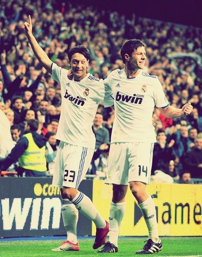 Xabi Alonso and Mesut Ozil