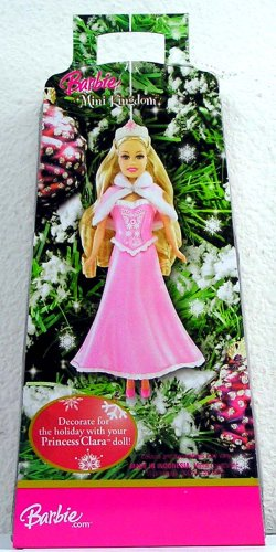 Barbie in the Nutcracker achtergrond possibly with a bouquet and anime called Clara Christmas Ornament doll in the box