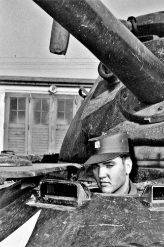 Elvis Presley in the drivers আসন of a tank in Germany, 1958.