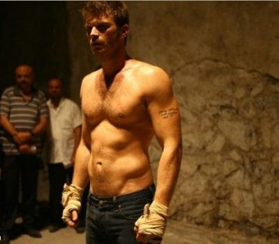 Kivanc Tatlitug's muscular body