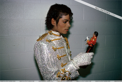 Michael Playing With A Doll In His Own Likeness