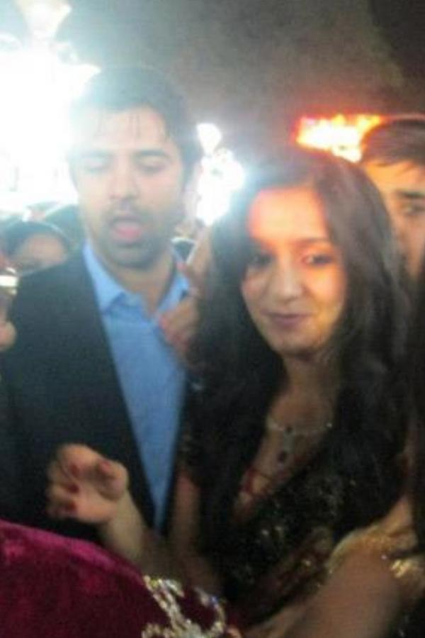 with his wife Pashmeen