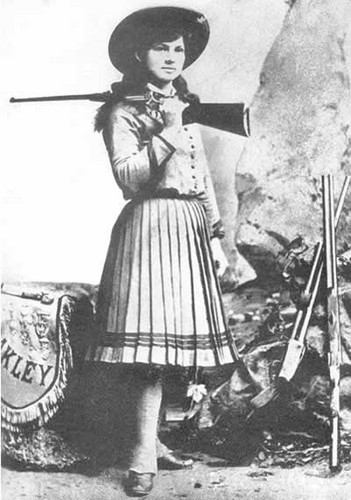 Women in History wallpaper possibly containing a boater, a fedora, and a musket titled Annie Oakley