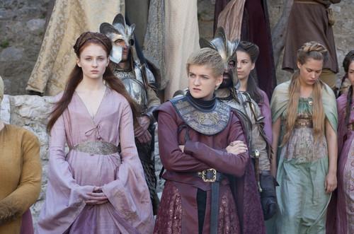 Game of Thrones wallpaper containing a kirtle entitled Joffrey Baratheon & Sansa Stark