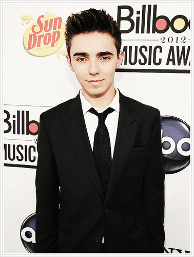 The Wanted Hintergrund with a business suit, a suit, and a three piece suit entitled Nathan Sykes xx