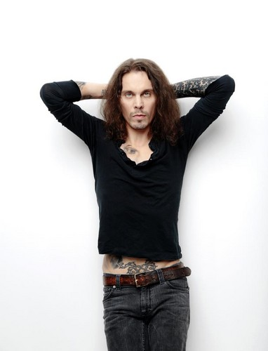 Ville Valo 壁纸 possibly with a pantleg, a hip boot, and a legging called New 照片 2012