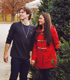 Ian Somerhalder and Nina Dobrev wallpaper probably with an outerwear, a box coat, and an overgarment titled » Ian & nina «