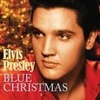 Elvis Presley photo possibly with a portrait called Blue Christmas