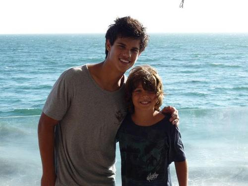 Taylor Lautner wallpaper probably with an oceanfront and a bather titled Childhood Photos
