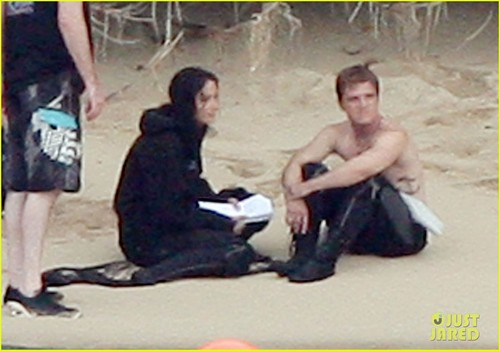 Peeta Mellark fondo de pantalla possibly with a baloncesto player entitled Jennifer Lawrence & Shirtless Josh Hutcherson: 'Catching Fire' Sea Scenes!