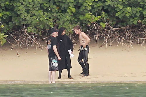 Peeta Mellark and Katniss Everdeen wolpeyper possibly with a business suit and an oceanfront titled Jennifer Lawrence & Shirtless Josh Hutcherson: 'Catching Fire' Sea Scenes!