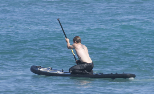Josh surfing in Hawaii