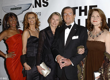 Sir Roger Moore And The Former Bond Girls