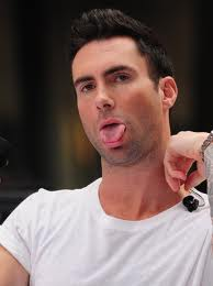 Adam Levine sicking his tongue out