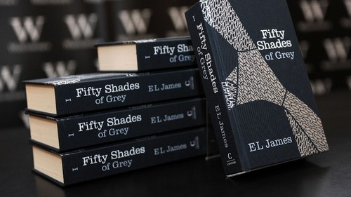 Fifty Shades Trilogy karatasi la kupamba ukuta probably containing a packing box entitled Fifty Shades of Grey