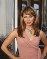 Melinda Clarke as Julie Cooper in The OC