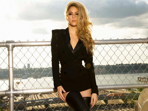 Shakira wallpaper containing a chainlink fence and a business suit entitled  Shakira
