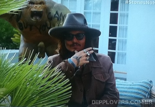 Johnny Depp and his home gorilla in a congratulatory video for the Rolling Stones
