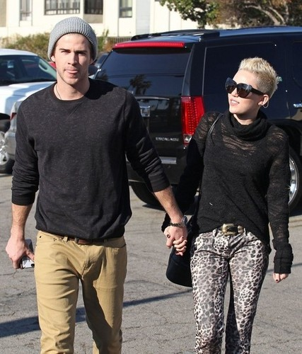 Miley Cyrus and Liam Hemsworth stopping by a Starbucks on Saturday (December 22) in Toluca Lake