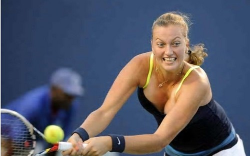 Tennis wallpaper containing a tennis racket, a tennis pro, and a tennis player called Petra Kvitova breast..