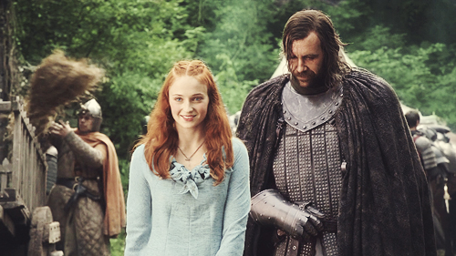 Game of Thrones wallpaper possibly with a surcoat and an outerwear called Sandor Clegane & Sansa Stark