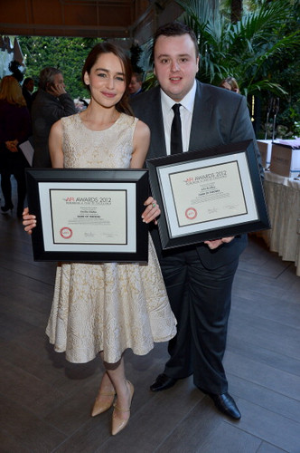 Emilia & John accepting Game of Thrones' award for TV Program of the anno