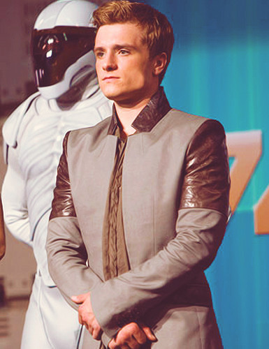 Peeta Mellark wallpaper containing a business suit entitled Josh Hutcherson as Peeta Mellark in The Hunger Games: Catching Fire