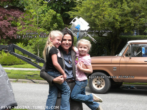 Lana posing with some children