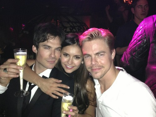 Ian Somerhalder and Nina Dobrev wallpaper probably with a business suit called Nian party