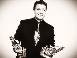 Nathan Fillion fond d'écran with a business suit, a suit, and a three piece suit called PCA 2013