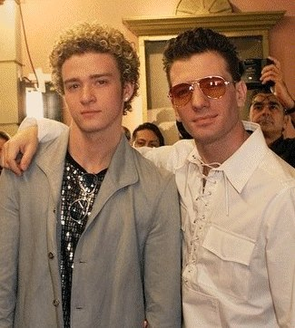 Justin Timberlake and JC Chasez wallpaper possibly containing a business suit, a well dressed person, and a suit called jc & justin