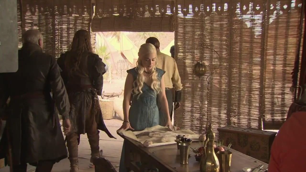 Daenerys, with the backs of Jorah Mormont, Daario Naharis (long hair)