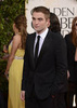 Robert Pattinson bức ảnh possibly containing a business suit entitled Robert Pattinson at the 2013 70th Golden Globes