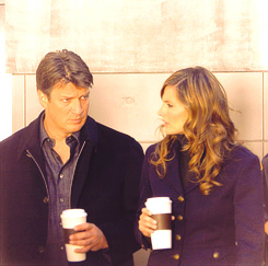 Nathan Fillion & Stana Katic karatasi la kupamba ukuta probably with a business suit called StaNathan<3