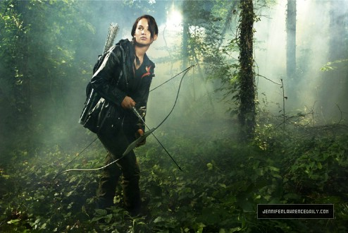 Katniss Everdeen achtergrond possibly with a douglas fir, a hemlock, and a ponderosa entitled The Hunger Games